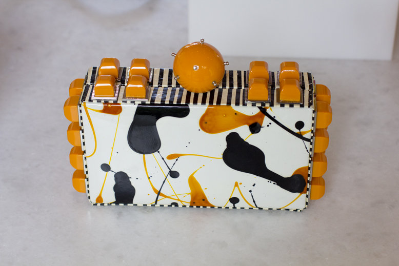 Tonya-Hawkes-orange-white-clutch